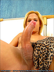 Brazilian tranny Michelly Cherry strips in front of the camera