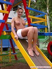 Blonde shemale shows hard monster cock in a play ground