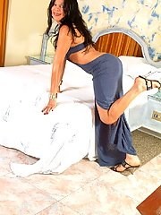 High heeled shemale in long dress shows her big cock